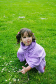 Beautiful girl playing on green grass, summer — Stock Photo