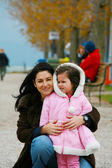 Portrait of a young woman with a little girl — Stock Photo