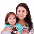 Smiling embracing mom and daughter looking at camera — Stock Photo #8007590