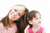 Teen sister and baby sister. Cute sisters portrait, close up, i — Stock Photo