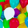 Many colored balloons forming a bright background wallpaper imag — Lizenzfreies Foto