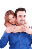Woman holding with love her boyfriend from behind, posing at cam — Stock Photo