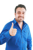 Happy casual young man showing thumb up and smiling 1 isolated o — Stock Photo
