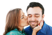 Lovely woman kissing her boyfriend, isolated on white — Stock Photo