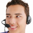 Smiling businessman talking on headset against a white backgroun — Stock Photo