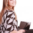 Portrait of beautiful woman using laptop while looking at you — Stock Photo