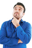 Young man in thoughtful pose. Isolated over white. — Stock Photo