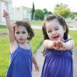 Stock Photo: Beautiful little girls enjoying outside