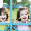 Stock Photo: Portrait of happy two sisters outdoors having fun