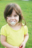 Baby girl with pacifier — Stock Photo