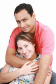 Young happy couple on white background — Stock Photo