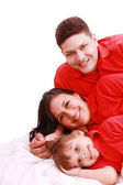 A family portrait of mom, dad and their daughter — Stock Photo