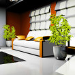 Waiting room with orange and white leather furniture — Stock Photo