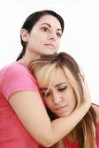 Mujer de tristeza en brazos amigos, aislado en blanco — Foto de Stock