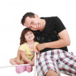 Father and daughter playing together and looking camera — Stock Photo