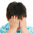 Very cute little boy with sad expression and hands on face — Stock Photo #9023386