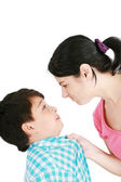 Boy confronts his mother isolated on white background — Stock Photo