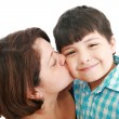 Adorable mother kissing her beautiful son isolated on white back — Stok fotoğraf