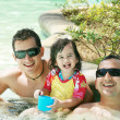Happy family having fun in swimming pool. Brothers and niece ha — Stock Photo