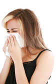 Closeup of gorgeous caucasian woman with cold sneezing into tiss — Stock Photo