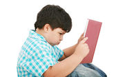 Young boy tries to do his homework — Stock Photo