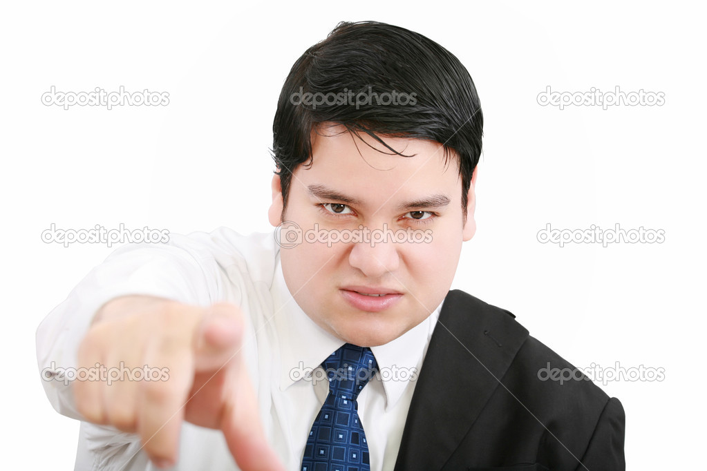 Portrait of an angry young business man in suit pointing at you isolated over white background — Stock Photo #9418284
