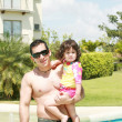 Father and daughter beside the swimming pool — Stock Photo