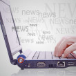Stock Photo: Image of hand on the laptop keyboard with the word news out of t