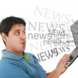 Man in laptop with the word news coming out of the screen — Stock Photo
