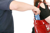 Man pickpocketing a purse from woman's bag — Stock Photo
