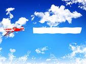 Banner de publicidad tirando biplano aviones — Foto de Stock