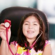 Cute little girl is playing doctor with stethoscope, isolated ov — Stock fotografie