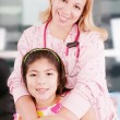 Little cheerful girl visiting the doctor — Stock Photo