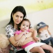 Стоковое фото: Mother and daughter in the waiting room at doctors office.