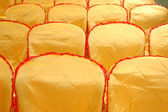 Rows of seats with a golden yellow cover — Stock Photo