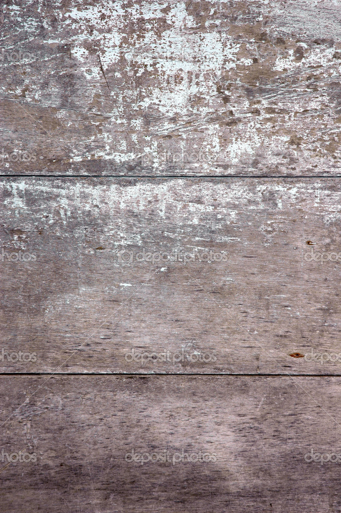 Texture of the grey wall that has old wooden boards and the paint faded — Stock Photo #8557280