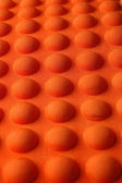 Detailed pattern of orange and brown seat cushion — Stock Photo