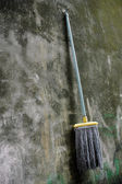 Mop hanging on a wall — Stock Photo