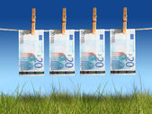 Banknotes hanging on laundry line. — Stock Photo