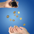 Coins and hands — Stock Photo