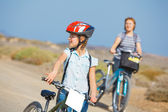 Girl and her grandmother on bikes — Stock Photo