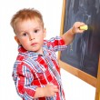 Little boy draws on the board - 图库照片