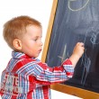 Little boy draws on the board — Stock Photo