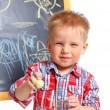 Little boy draws on the board — Stock Photo
