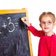 Little girl draws on the board — Stock Photo