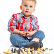 Little boy plays chess. — Stock Photo