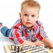 Royalty-Free Stock Photo: Little boy plays chess.