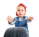 Little mechanic with a tire — Stock Photo