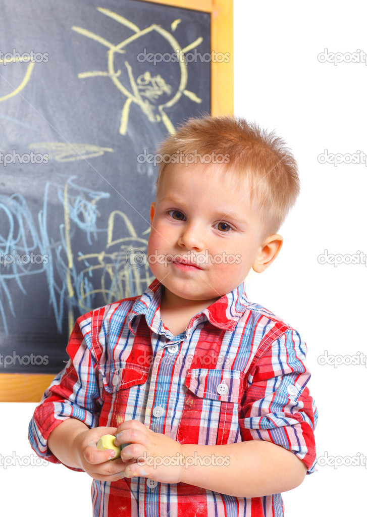 Portrait of llittle boy is drawing on a blackboard. Isolated on white background — Stock Photo #10197834