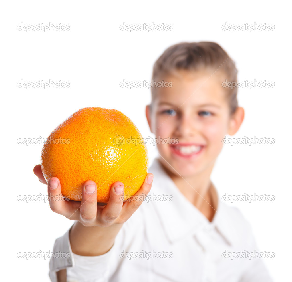 Portrait of happy cute little girl with orange. Focus on the orange. Isolated over white background. — Stock Photo #10197880